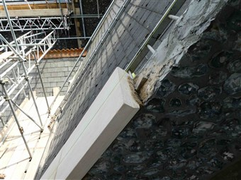 Repairs to the coping stones towards the top of the North Transept